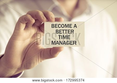 Businessman Holding Become A Better Time Manager Message Card