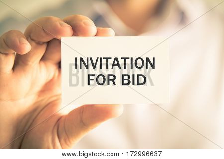 Businessman Holding Invitation For Bid Message Card