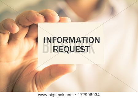 Businessman Holding Information Request Message Card