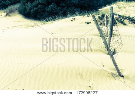 Stunning Mangawhai Heads sand dunes with old fence in split tone