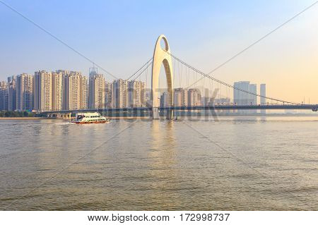 Modern bridge in Zhujiang River and modern building of financial district in guangzhou city China