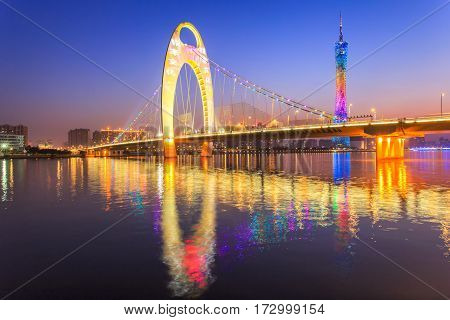 River with modern city landmark architecture backgrounds of pink clouds in Guangzhou China Zhujiang River and modern building of financial district in guangzhou