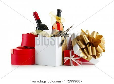 Decorated wine bottles and gift boxes on white background