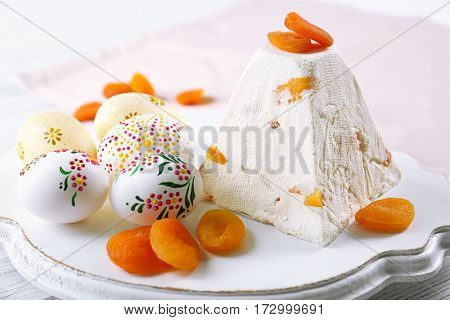 Wooden stand with traditional Easter curd dessert on table
