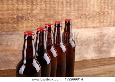 Bottles of beer on wooden background