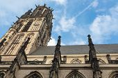 View at Salvator church with black soot in Duisburg Germany poster