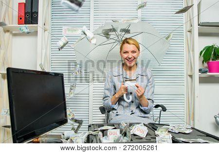 Accountant With Pile Money Hide Under Umbrella. Accountant Enjoy Cash Rain In Office. Cash Rain Conc