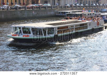 St. Petersburg, Russia - July 13, 2018: Excursion And Tour Cruise Boat On Neva River Water. Cruise S