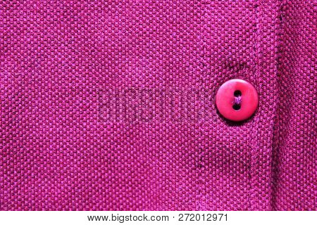 Single Button On Purple Colorful Shirt Close Up View. Fabric Canvas Backdrop Of Buttoned Cotton Casu