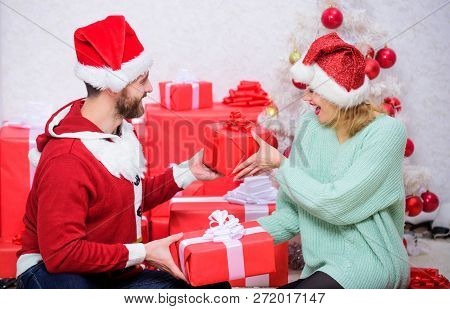 Opening Christmas Present. Couple In Love Happy Enjoy Christmas Holiday Celebration. Loving Couple C