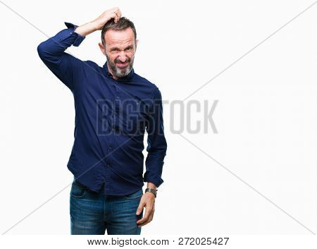 Middle age hoary senior man over isolated background confuse and wonder about question. Uncertain with doubt, thinking with hand on head. Pensive concept.