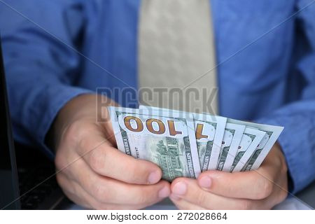 Man Holding Us Dollars In Hands, Close-up. Clerk, Official, Manager Or Businessman Counts The Money