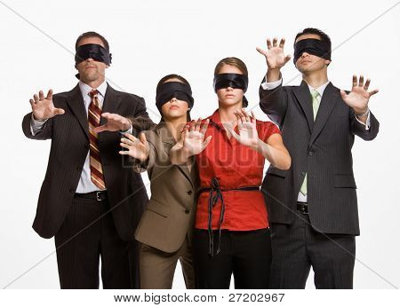 Business people in blindfolds