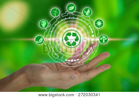 Hand Holding With Environment Icons Over The Network Connection On Nature Background, Technology Eco