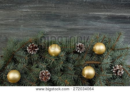 Christmas Composition Of Fir Branches And Christmas Tree Decorations On A Wooden Background . Top Vi