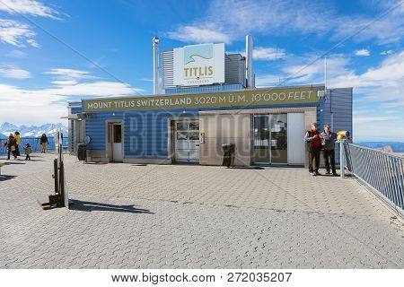 Mt. Titlis, Switzerland - October 12, 2015: People At The Building On The Top Of The Mountain. The T