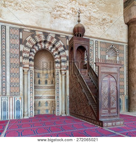 Cairo, Egypt - December 2 2018: Marble Wall With Engraved Niche And Wooden Platform At The Mosque Of