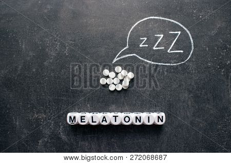 White Pills In Z Shape And Text. Sleeping Pills, Hypnotic Drugs, Sedative, Melatonin On Dark Night B