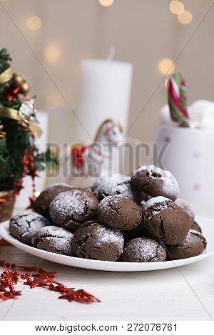 Chocolate brownie cookies in powdered sugar. Chocolate Crinkles.Chocolate crinkle cookies baked fresh sprinkled with powdered sugar poster