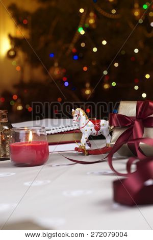 A Christmas Rocking Horse. Wooden Horse - Christmas Decoration - Background For A Greeting Card. Toy
