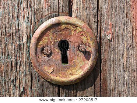 keyhole of old wooden door