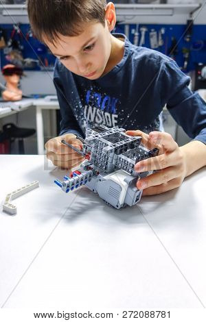 Vilnius, Lithuania - November 23, 2018: Kid Making Lego Robot Mindstorms. Robotic, Learning, Technol