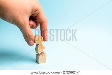 The Hand Of The Person Collects A Figure Of The Person Together. Psychological Assistance And Suppor