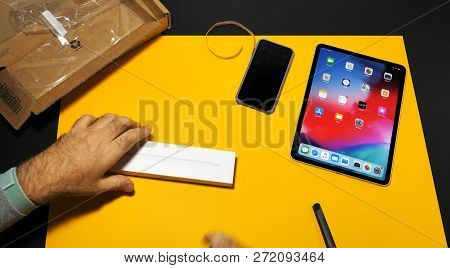 Paris, France - Nov 16, 2018: Man Opens The Box Of Apple Pencil 2 Next To Latest Ipad Pro Smart Tabl