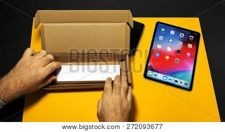 Paris, France - Nov 16, 2018: Man Unboxing Latest Ipad Pro Smart Tablet Device And Apple Pencil 2 Ma