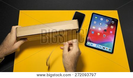 Paris, France - Nov 16, 2018: Man Open Cardboard Box With Apple Pencil Next To Latest Ipad Pro Smart