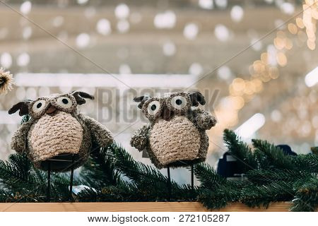 Two Cute Toy Owl On Fir Branch. Winter Still Life With Two Toy Owl