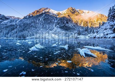 Winter Mountains. Winter Scene. Snowy Mountains With Sunshine Reflecting In Ice. Beautiful Landscape