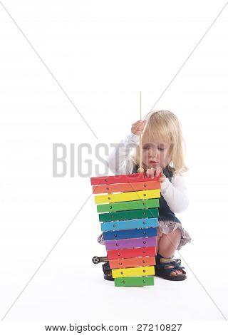 Little Blonde Girl Playing Musician