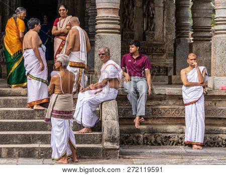 Belur, Karnataka, India - November 2, 2013: Chennakeshava Temple. Group Of Men And Women Wait In Fro