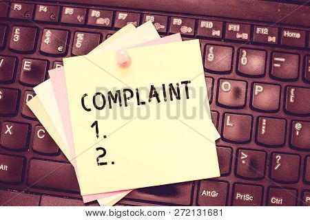 Conceptual hand writing showing Complaint. Business photo text statement that something is unsatisfactory or unacceptable Blank Notepad Sheet with Push Pin for Reminding on Laptop keyboard. poster