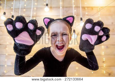 Portrait Of A Teen Girl In A Costume Of A Cat