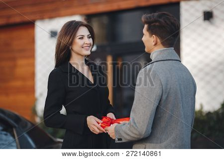 Holidays and events. A gift for the woman he loved.Couple in love. Family couple of man and sexy gir
