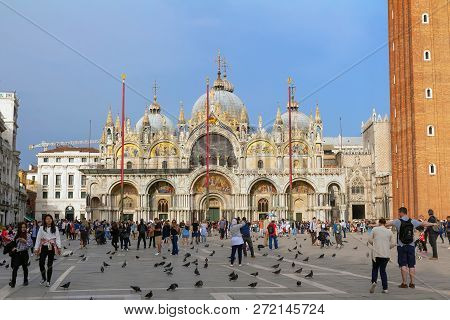 Venice/italy - April 16, 2018: View Of Piazza San Marco With People, Pigeons And Basilica San Marco.