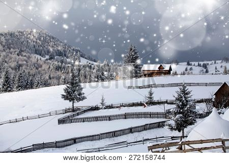 Fairy winter landscape in the Carpathian Mountains. Snow covered small mountain village.