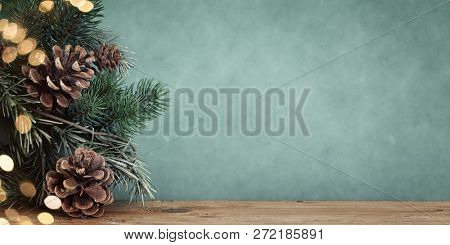 An image of a twig with pine cones bokeh background