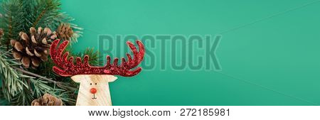 A Christmas decoration with a reindeer green background