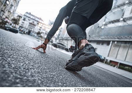 Close Up Feet With Running Shoes And Strong Athletic Legs Of Sport Man, Athlete Man In Running Pose