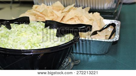 Shredded Lettuce And Nacho Chips On Mexican Food Buffet