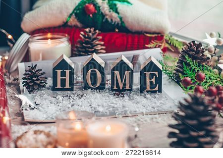 Concept Of Home And Comfort. Christmas Decor Warm Sweater, Candles, Led String Lights And Christmas