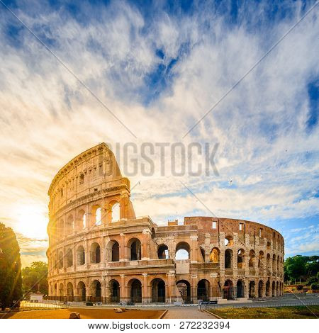 Colosseum At Sunrise, Rome. Rome Architecture And Landmark.