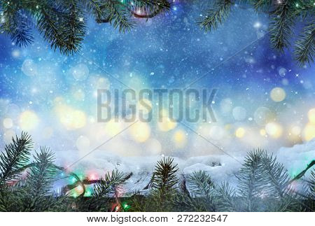 Winter Design.  Christmas Background With Fir Tree And  Frozen Wooden Table With Bokeh. Snow And Ice