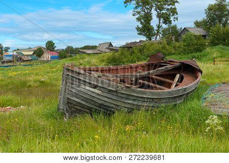 Old Broken Boat Lies On The Shore, Solovetsky Islands, Arkhangelsk Region, Russia