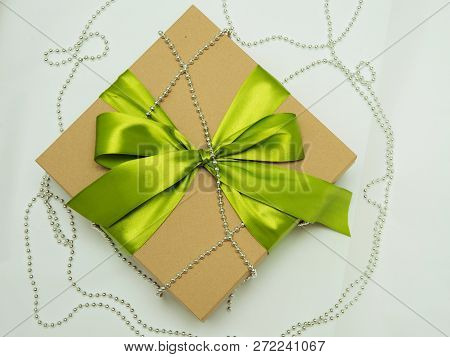 Gift Box Tied With Green Ribbon And Silver Beads, Christmas Gift, Valentines Day Gift, White Backgro