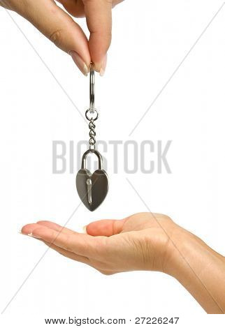 trinket in hands is isolated on a white background