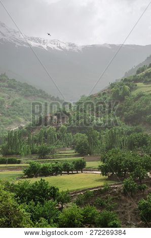 The River Near Old Afghanistan Village In Pamir Mountains